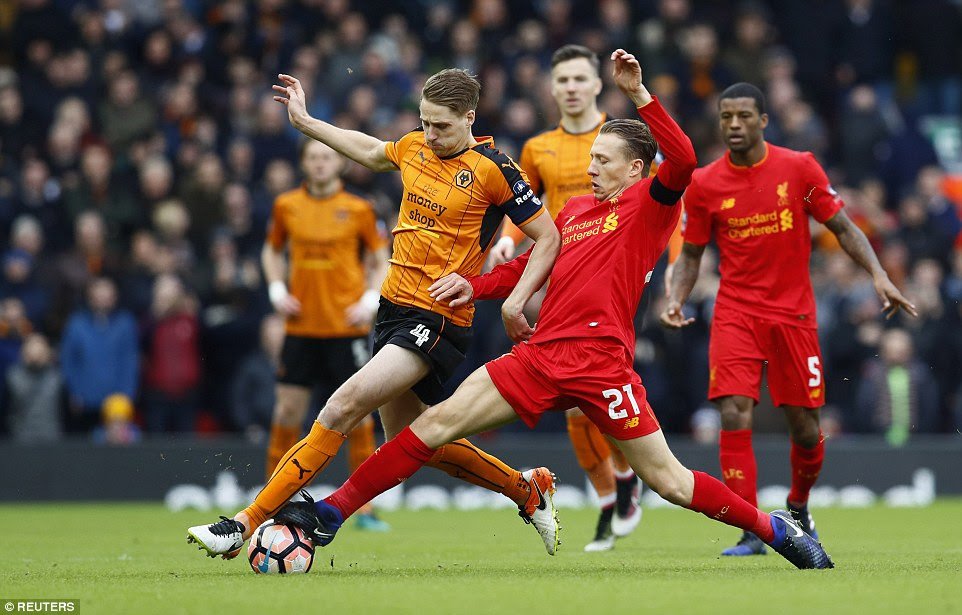 Liverpool captain for the day Lucas Leiva stretches to challenge Wolves midfielder Dave Edwards for the ball