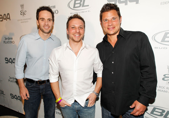 (L-R) NASCAR driver Jimmie Johnson, singer/TV personality Drew Lachey and singer/TV personality Nick Lachey attend the Super Skins Kick Off Party at Hotel 944 featuring Snoop Dogg at The Eden Roc Renaissance Miami Beach on February 4, 2010 in Miami Beach, Florida.