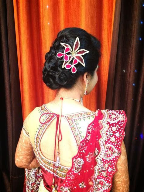 Indian bride's bridal reception hairstyle by Swank Studio