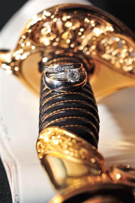 Marine Corps Wedding, Our rings on his sword, USMC Wedding