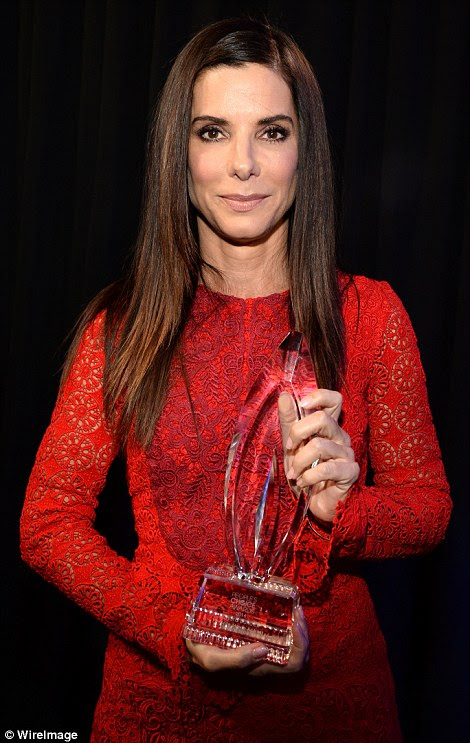 Big winners: Favorite Movie Actress Sandra Bullock (L) andFavorite Dramatic Movie Actor Johnny Depp skipped the carpet, but happily posed backstage with their awards