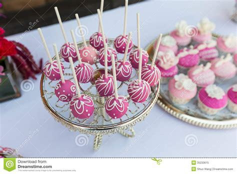 Cake pops and cupcakes stock image. Image of flowers