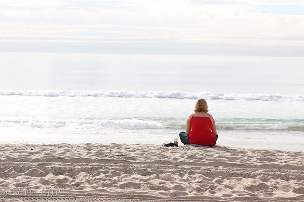 Woman alone at the beach