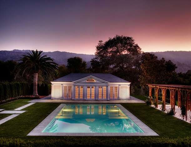 Pool and pool house at dusk