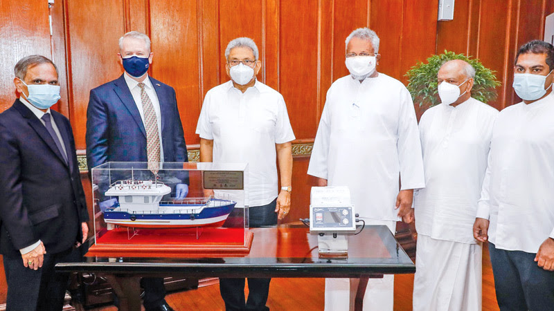President Gotabaya Rajapaksa after accepting the Multi-Day Fishing Vessel Monitoring System from Australian High Commissioner David Holly, along with Ministers Dinesh Gunewardena, Douglas Devananda and State Minister Kanchana Wijesekara and other officials.