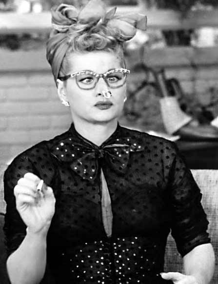 Screen still of Lucille Ball abominably glamorizing cigarette smoking
