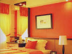 bedroom wall paint ideas with orange color theme - www.