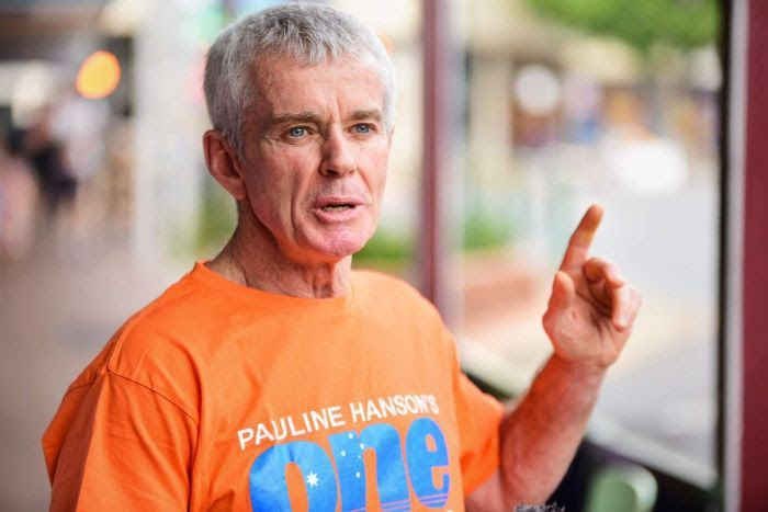 Malcolm Roberts speaking holding his finger up as he speaks