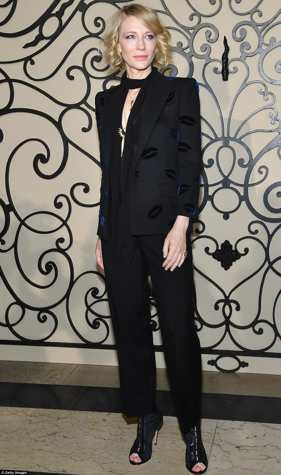 Getting lippy: Cate Blanchett later added to the fray in a black jumpsuit and blazer - adorned with the playful embroidered images of lips all over, in contrasting blue velvet