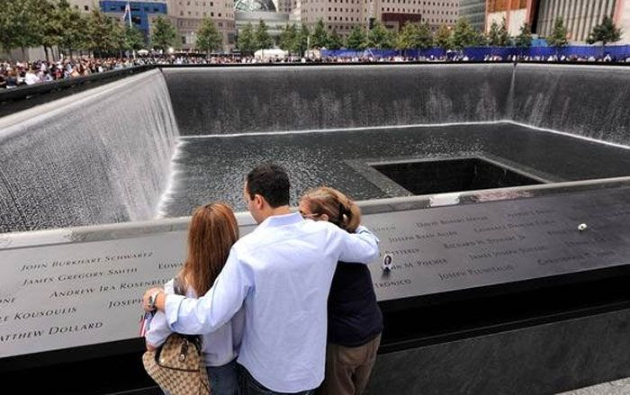 Family members of those who died in the World Trade Center attacks gather at the National September 11 Memorial on the 10-year anniversary of the tragedy.
