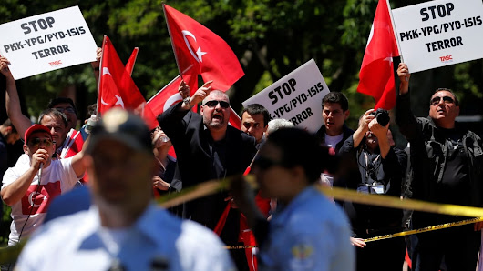 Turkish president's bodyguards blamed after protesters beaten bloody in Washington