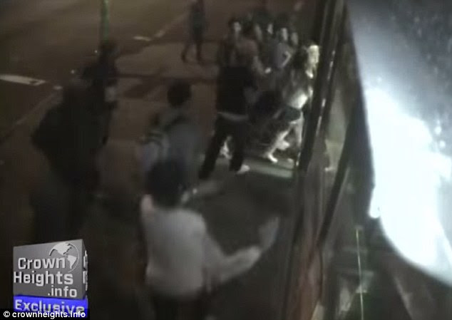 Ambush: Dozens of teens unexpectedly swarmed a Crown Heights deli at around 9pm on Saturday night