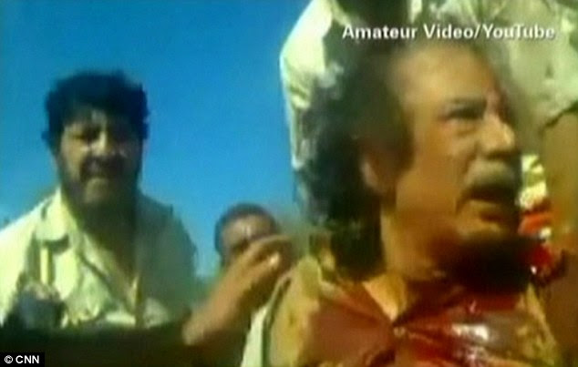 Fear on his face after being captured in his home town of Sirte, this is Gaddafi in the moments leading up to his death