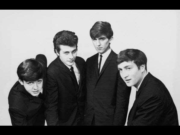 An early portrait of the British rock group The Beatles. Left to right: Paul McCartney, Pete Best, George Harrison (1943 ­ 2001) and John Lennon (1940 ­ 1980).