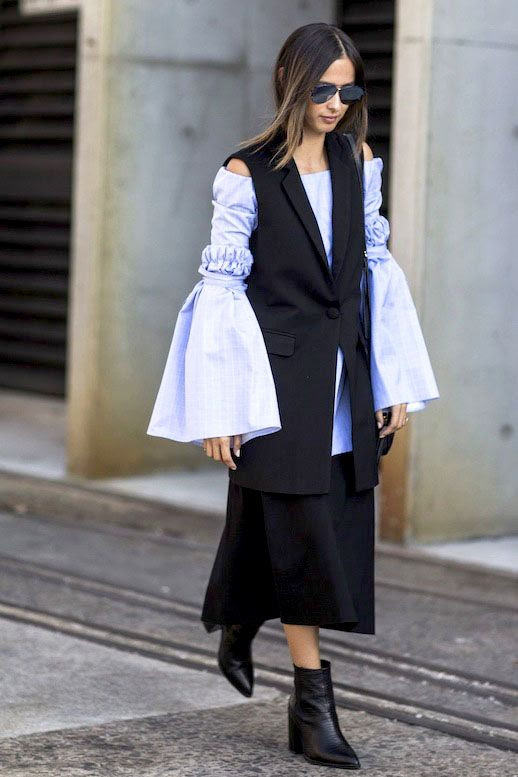 Le Fashion Blog Fall Editor Style Layered Look Sfw Eleanor Pendleton Sunglasses Sleeveless Blazer Blue Statement Sleeve Top Black Midi Skirt Leather Ankle Boots Via Refinery29