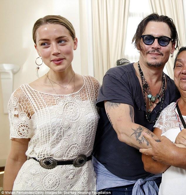 Newlyweds!  Depp pode em breve se tornar pai novamente, graças ao seu 29-year-old noiva de sete meses Amber Heard (foto 24 de setembro)