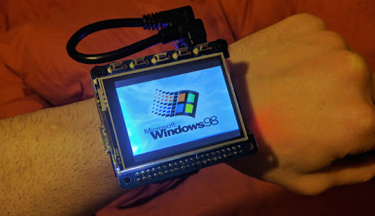 This smart watch is actually a Raspberry Pi computer running Windows 98