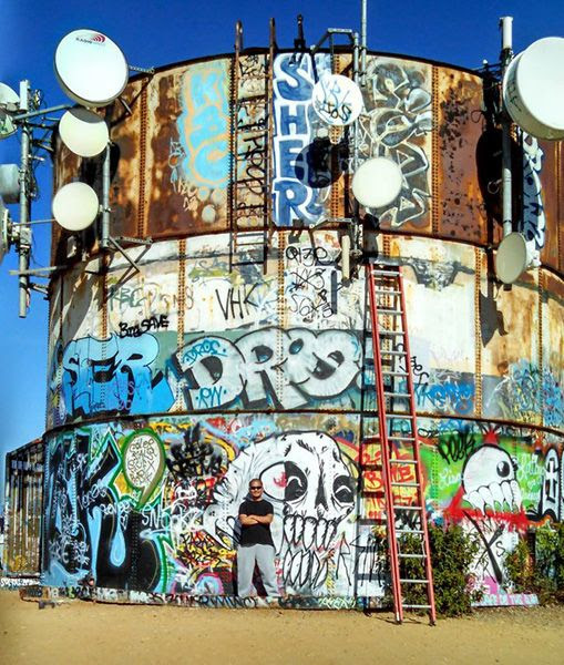 Posing in front of a water tank/cell tower/whatever in Whittier, CA...on November 24, 2014. Nancy took the photo.