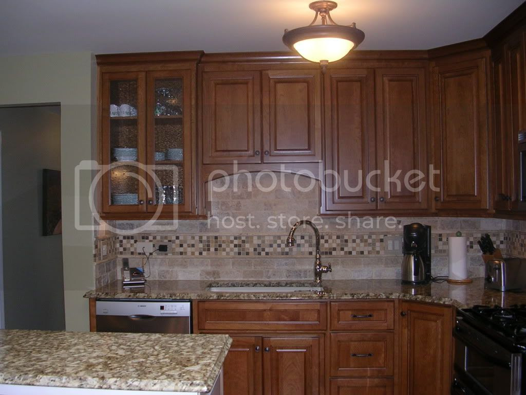 Subway Tile Backsplash with Cherry Cabinets