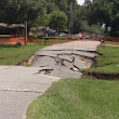 Large Sinkhole Swallows Street and Threatens Homes in Spring Hill Florida - Blog. by MoversAtlas