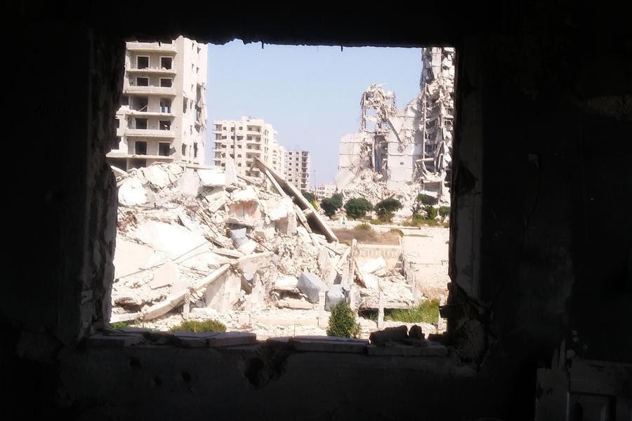 Imagen de la destrucción provocada en el barrio de Al Waer, en Homs (Foto: Pablo Sapag M.)