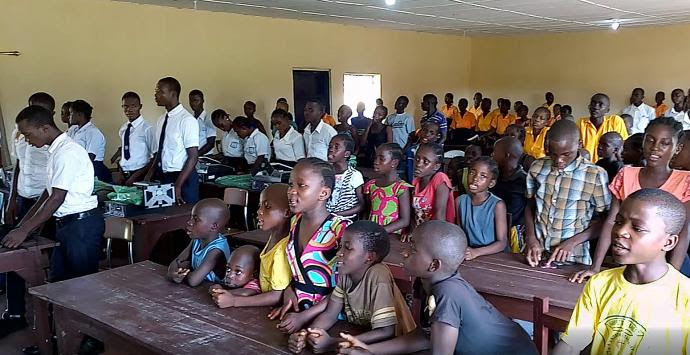 Children sing during a celebration marking the gift of solar power, funded by the United Methodist Church in Norway, to the Bishop Judith Craig Children Village in Liberia.