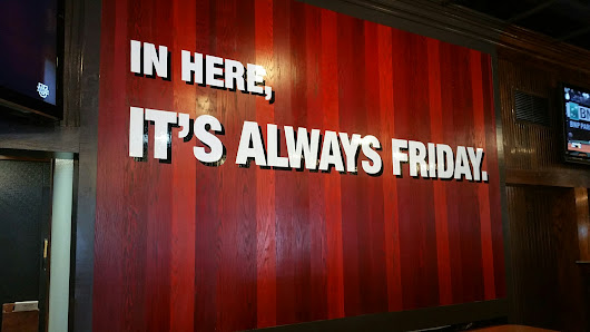 TGI Fridays – painted promise wall