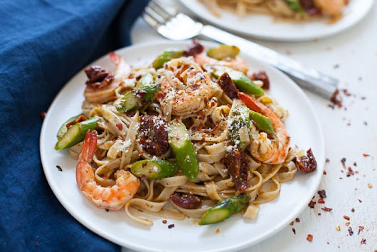 Easy Shrimp Pesto Pasta with Asparagus and Sun-Dried Tomato - The Foodie Dietitian