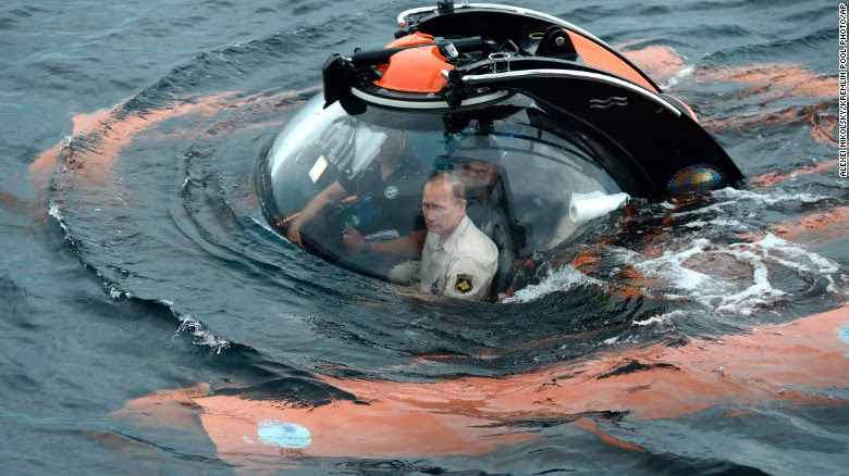 Russian President Vladimir Putin sits in a bathyscaphe as it plunges into the Black Sea along the coast of Sevastopol, Crimea, on Tuesday, August 18. Putin plunged into the sea to see the wreckage of an ancient merchant ship that was found in the end of May. Browse through for more photos of Putin trying his hand at different activities.