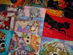 cat quilting on cat fabric in cat charm quilt