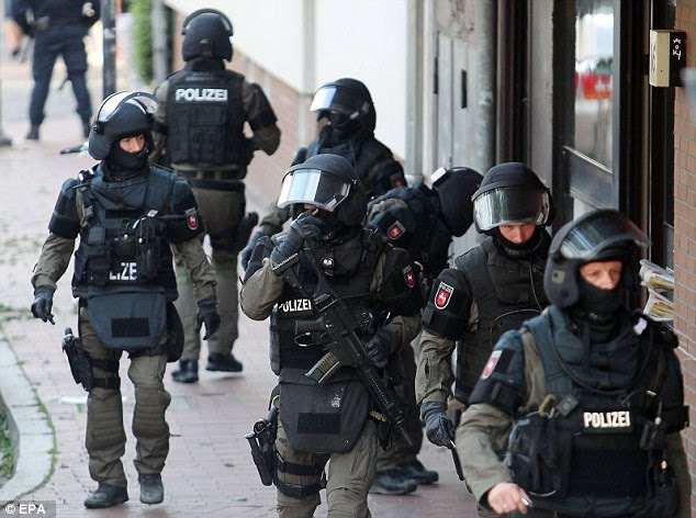 Raid: German armed police officers launched a raid on a mosque and eight private apartments in Hildesheim, Lower Saxony, on Wednesday night