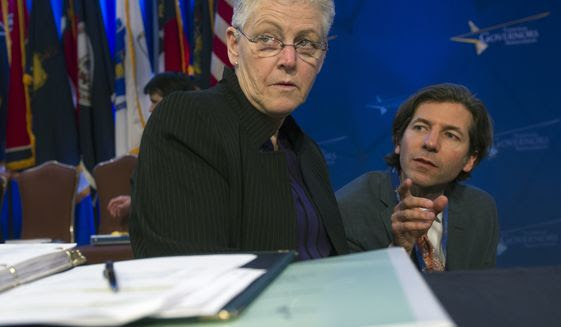 Environmental Protection Agency (EPA) Administrator Gina McCarthy confers with an aide as she prepares to address the Natural Resources Committee session during the National Governors Association Winter Meeting in Washington, Sunday, Feb. 22, 2015. (AP Photo/Cliff Owen)
