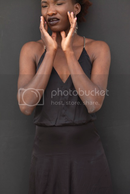 Black silk dress on a black woman