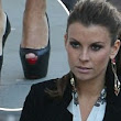 Sky high mama! Pregnant Coleen Rooney pulls on some serious Louboutins for fashion show
