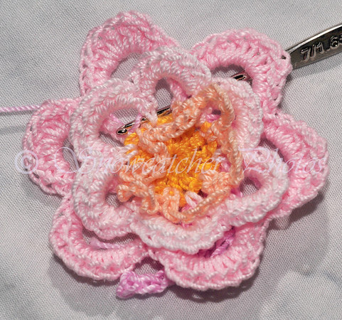 1 double crochet through single base of next single crochet petal