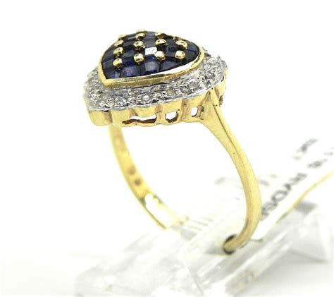 ladies  yellow gold sapphire diamond heart ring