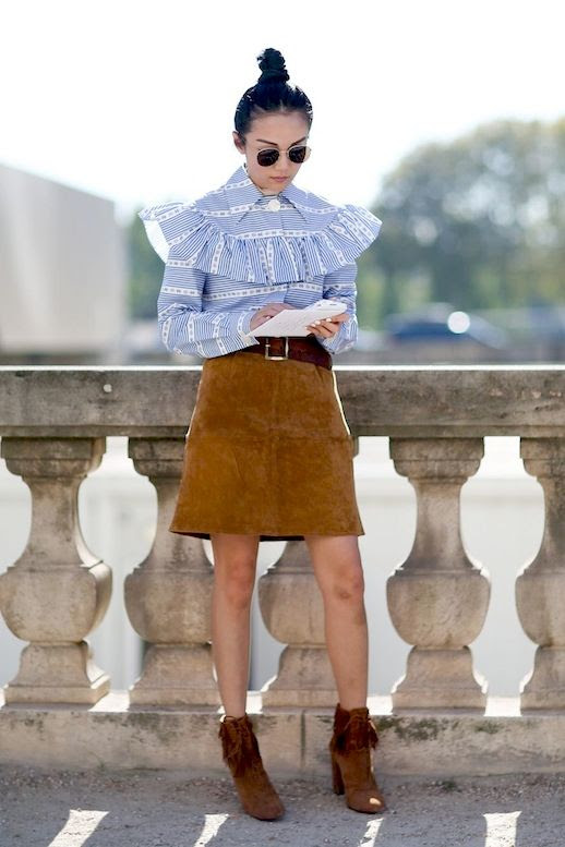 Le Fashion Blog Street Style Pfw Sunglasses Top Knot Prairie Inspired Print Ruffle Top Brown Suede Skirt Fringed Booties Via Refinery29