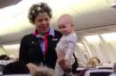 Southwest flight attendant walks plane aisle with baby to give tired mother a break
