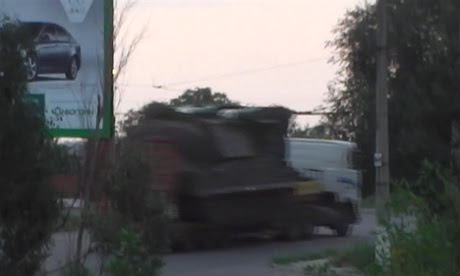 A still taken from a video made available by the Ukrainian Interior Ministry, purportedly showing a truck carrying a Buk missile launcher.