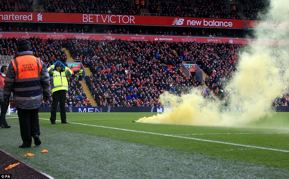 The Wolves fans celebrated the early opener in the lunchtime kick-off at Anfield by chucking a flare onto the pitch
