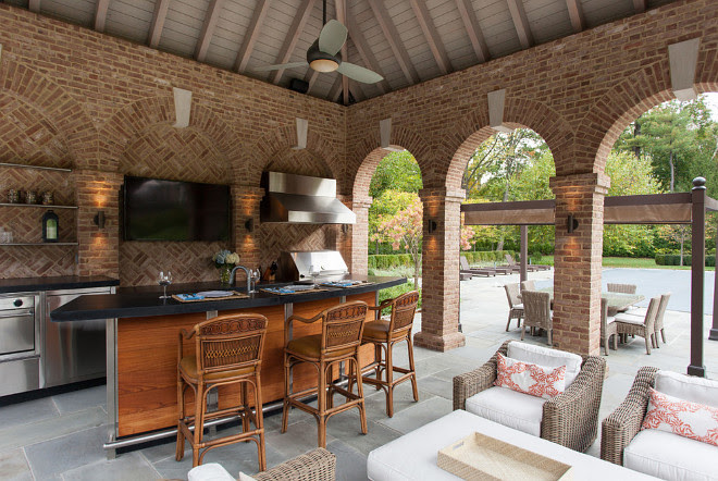The pool pavilion dining area is serviced by a professional grill and gas oven #PoolHouse #poolPavilion #PoolPavilionInterior #poolPavilionIdeas Douglas VanderHorn Architects