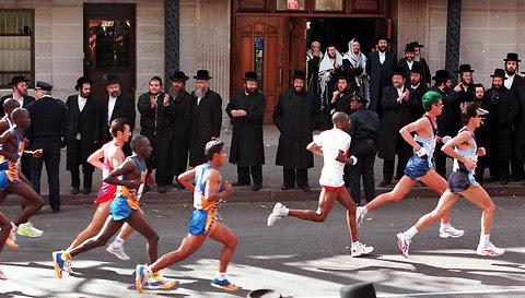 Marathon runners blaze a quiet trail through the Hasidic section of Williamsburg.