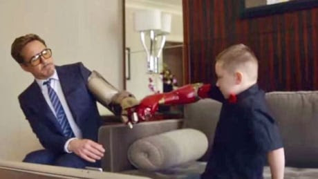 Robert Downey Jr. brings Iron Man arm to boy born without one