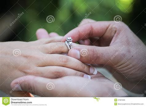 Placing Wedding Ring On Finger Stock Photo   Image: 27901626