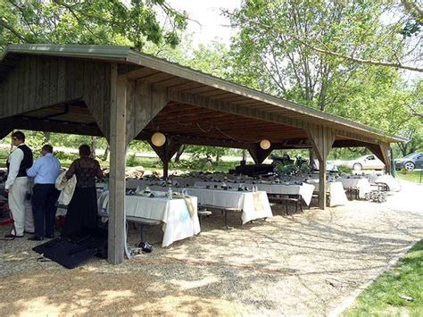 picnic shelter decorated for wedding with linens on tables