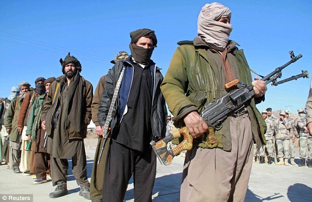 Unbowed: The document claims Taliban fighters are being supported by Pakistan intelligence services across the border