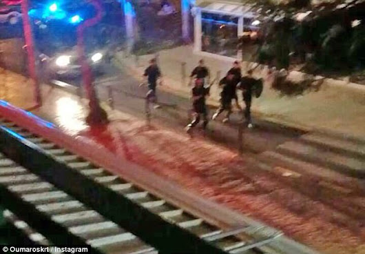 Police open fire as they clash with British tourists on the streets of Algarve