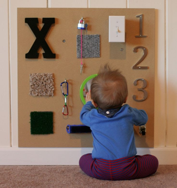 Do It Yourself Sensory Boards.  Clever ideas for baby and toddler, as well as directions for a texture board with fabric circles