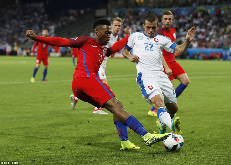 Sturridge runs out of wriggle-room inside the Slovakia penalty area as Viktor Pecovsky recovers to make an important tackle