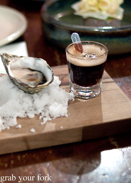 Oyster and Guinness shot with syringe